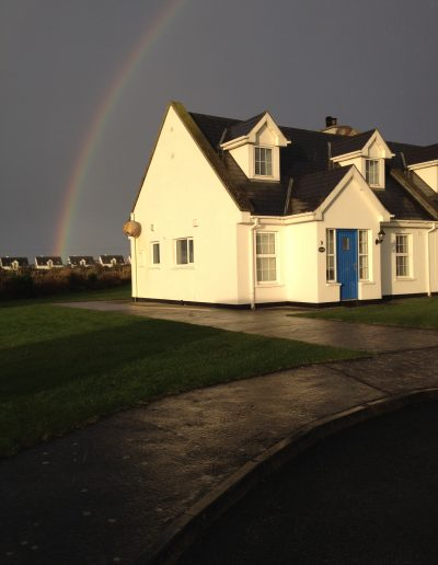 rainbow after the storm over cottage